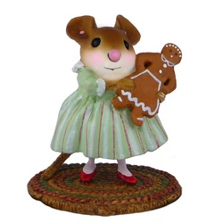 Girll mouse in green party dress holding a ginger bread woman