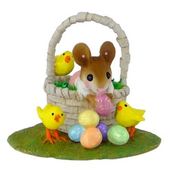 Girl mouse in side a basket with Easter eggs and little chicks