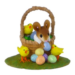 Boy mouse in Easter basket with Easter eggs and chicks