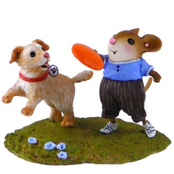 Boy mouse throughs a fisby for his dog