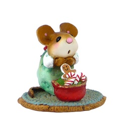 Girl mouse kneeling behind and pot full of Christmas candy