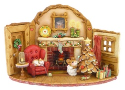 Indoor Chistmas seen with fireplace, cat on chair and mouse mouse decorating tree