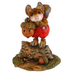 Mouse with squirrel costume holding acorn lamp