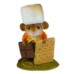 Mouse with marshmallow hat, choclate in one hand and cracker in other
