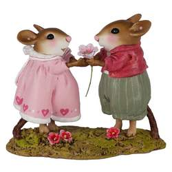 Boy mouse gives rose to girl mouse in