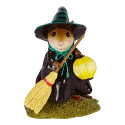 Little black witch holding yellow broom and lantern