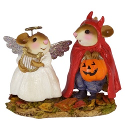 An angel (girl) and a devil (boy) mouse out for candy
