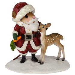 Santa hold carrot treat for a juvenile deer