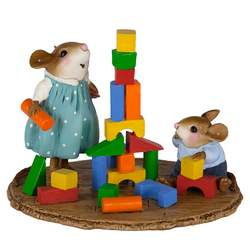 Girl mouse builds a wood block tower with little brother