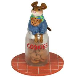 Boy mouse sits on top of class jar filled with cookies