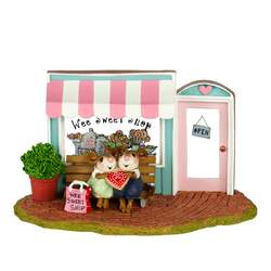 Loving couple share special cookie outside Wee Sweet Shop