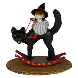 Girl witch sitting on a rocking black cat