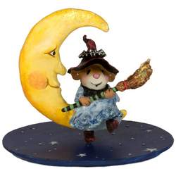 This little witch is hanging out on the moon