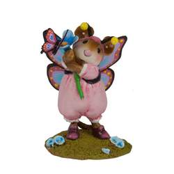 Girl mouse dressed as a butterfly holds a flower with a butterfly
