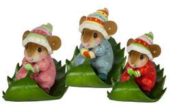 Young mouse in Christmas clothing rides holly leaf sled