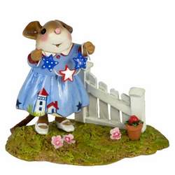 Female mouse decorating garden fence with patriotic stars