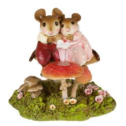 Loving mouse couple share an ice crean soda sitting on a toadstool