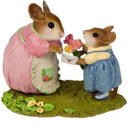 Daughter gives her mother mouse a letter and flowers