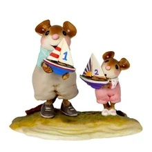 Dad and little girl mouse carrying their model  boats to the water.
