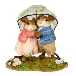 Young mouse couple sharing a decorated, transparent rain umbellar.
