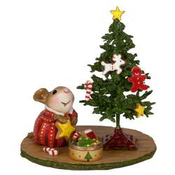 Young girl mouse decorates her tree