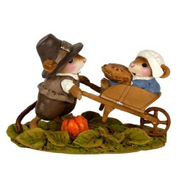 Pilgrim mouse pushes wife and Thanksgiving pie in his wheelbarrow.