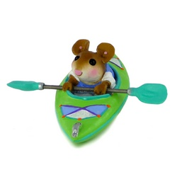 Mouse, holding his paddles out of the water, in a canoe