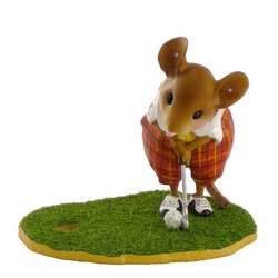 Male golfer mouse putting, dressed in tweed pants