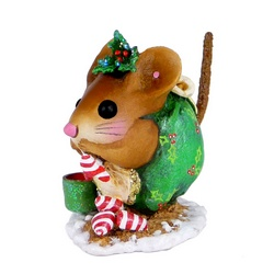 Curled up mouse in Christmas attire nibbles on tasty treats