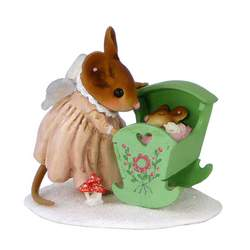 Mouse with angel wings rocking a crib