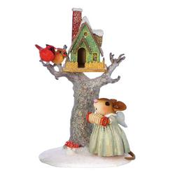 Christmas bird house in a tree with angel mouse at base