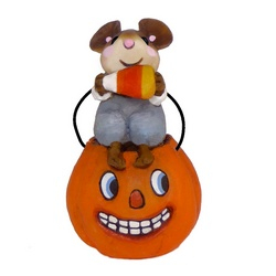 small mouse sits on oversized pumpkin bucket eating a candy corn