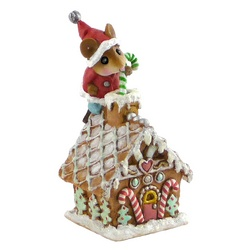 Mouse Santa standing on a Christmas gingerbread house